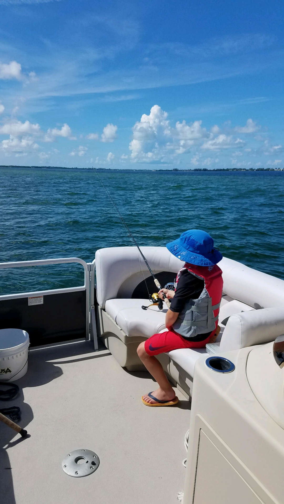Child fishing on the boat